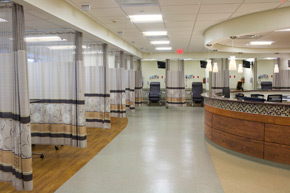The patient center's preparation and recovery areas look onto the central nursing station at the surgery center.