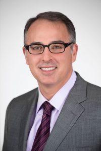 Dr. Joshua Greenwald smiles at the camera.